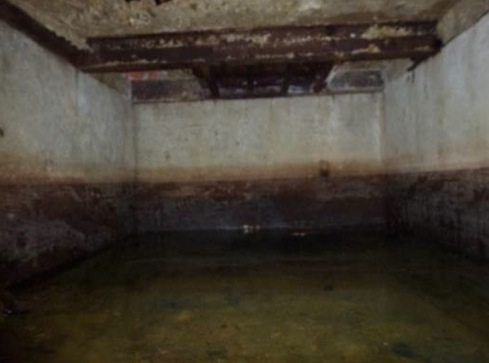 The inside of the cottage bunker prior to pumping the water out